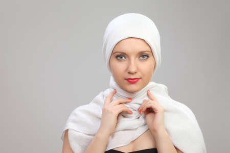 portrait of a young woman eastern type in the modern Muslim clothes and beautiful headdress Stock Photo