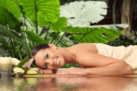 Beautiful Woman Getting Spa Massage in Spa Salon photo