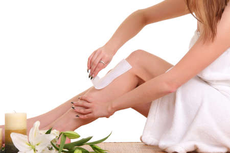 healer: A picture of a young woman waxing her legs over white background