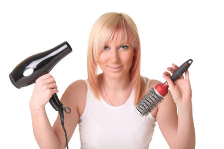 Woman with hair dryer and scissors Stock Photo