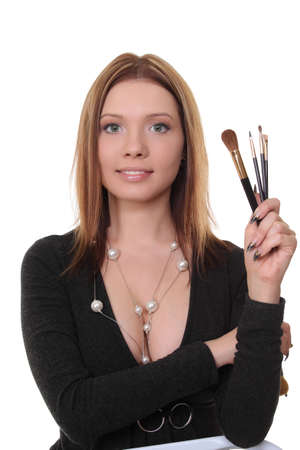 Portrait of a pretty young woman holding powder brush photo