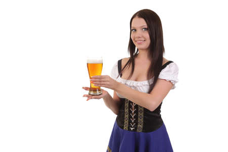 Beautiful young woman in traditional bavarian dress holding mug of beer. photo