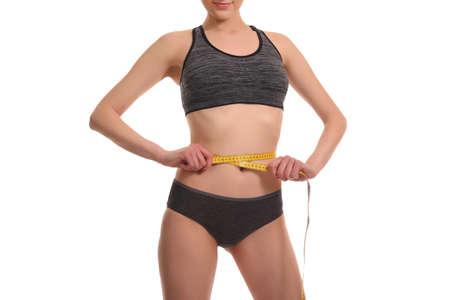 Closeup of tape measure around woman waist Stock Photo