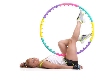 waistline: young sporty woman with hula hoop on a white background