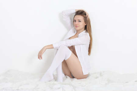 picture of beautiful woman in a white shirt and underwear Imagens