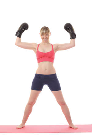 Girl in boxing gloves on a white background