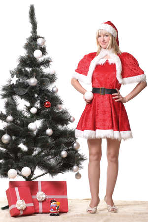 young woman in Santa Claus clothes with presents Stock Photo