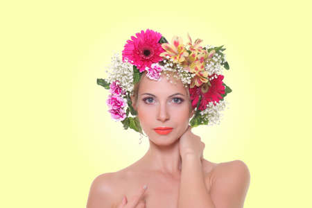 portrait of a beautiful girl with a hairdress from flowers