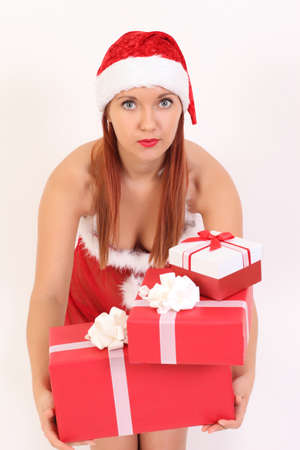 Young sexy girl with Christmas gifts on a white background