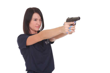 young police woman with gun on white background Foto de archivo