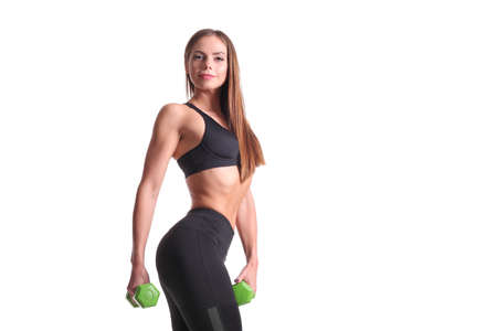 young sporty slim muscular girl with dumbbells Imagens