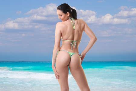 young girl in bikini is resting on the sea