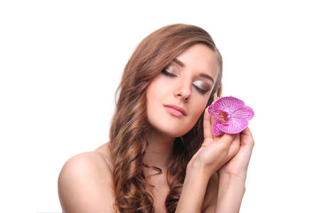 young tender beautiful girl with orchid Stock Photo