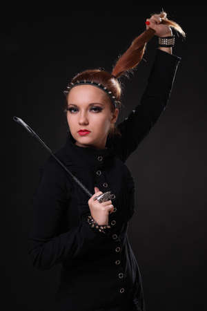 Young beautiful sexy girl in black clothes Foto de archivo