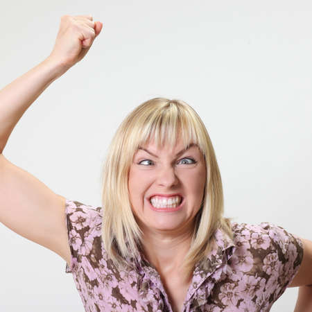 Crazy blonde woman makes squint for fun
