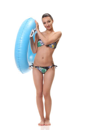 young positive girl with an inflatable circle Standard-Bild