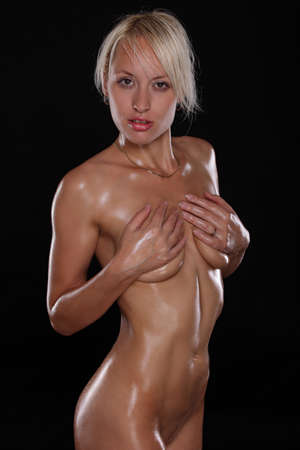 cute girl posing naked on black background
