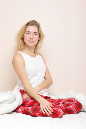 young beautiful girl in bed at home photo