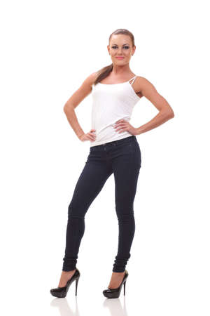 Full length portrait woman in a white tank top and jeans. Isolated. Banco de Imagens