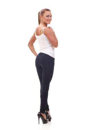 Full length portrait woman in a white tank top and jeans. Isolated.