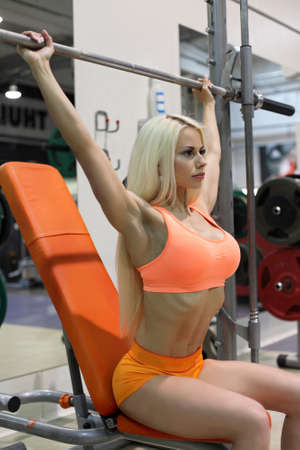 Fitness woman in gym , abs and flat belly