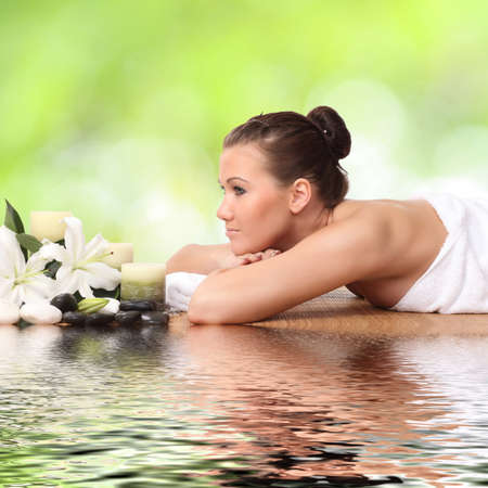 woman lying down relaxing on a massage bed at a spa