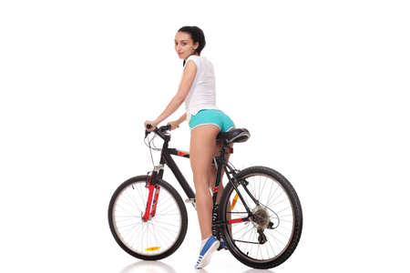 young athletic and slim girl on a bicycle