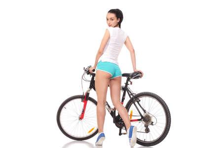 jeune fille athlétique et mince sur un vélo Banque d'images