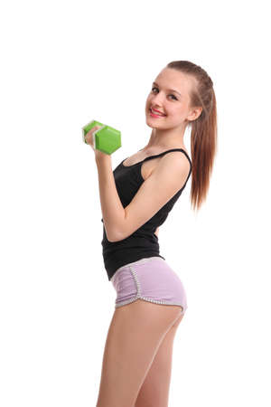 Sexy fitness girl with dumbbells on a white background