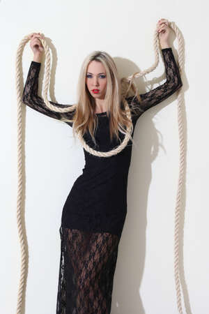 Young woman going to be hanged in black dress
