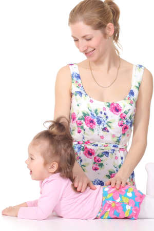 mother plays with her daughter and does massage, on white background