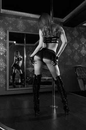 Sexy young pole dancer in black lingerie Reklamní fotografie