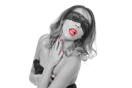 Beautiful sexy woman with blindfold eyes on a white background
