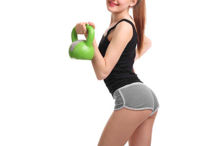 Nice young woman doing workout with dumbbell