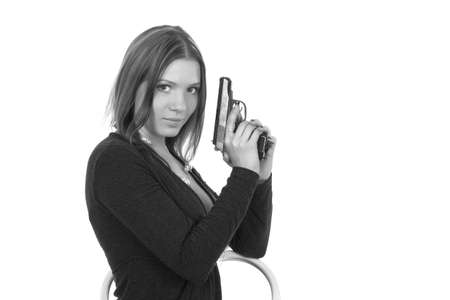 Beautiful girl with gun on white background