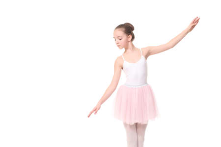 young beauty girl ballerina posing on white background 写真素材