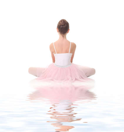 young beauty girl ballerina posing on white background