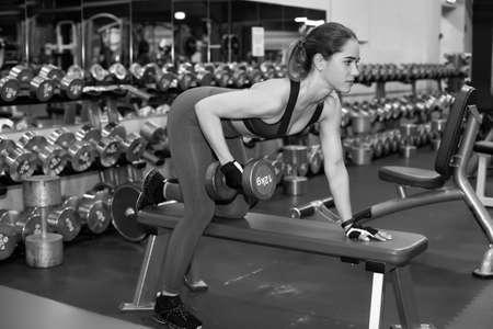 Young fitness woman doing training in the gym