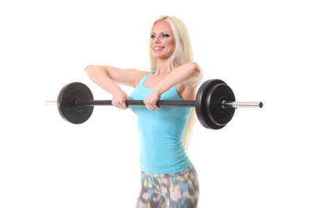 smiling sporty woman exercising with barbell on a white background Фото со стока