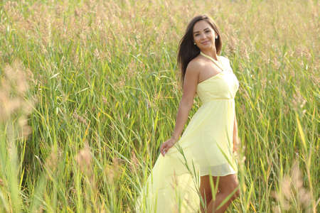 Beautyful young model girl outdoors enjoying nature 스톡 콘텐츠