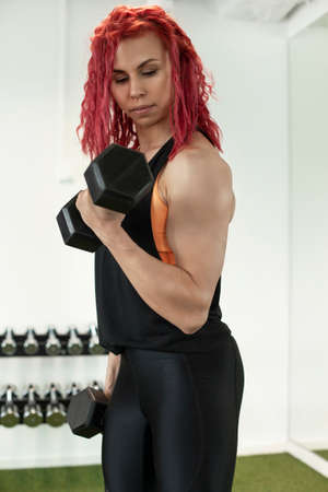 young beautiful fitness girl with muscular body