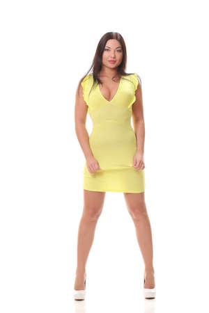 young woman in yellow dress on a white background