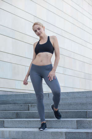 Fitness young sporty woman showing her well trained body Standard-Bild