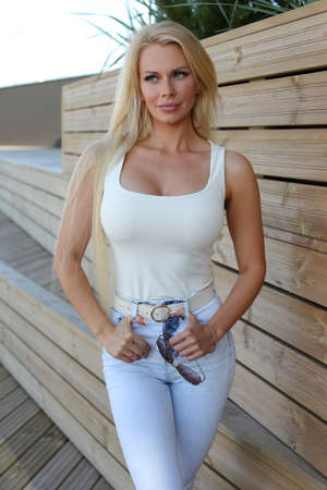 Young blonde in jeans and a tank top