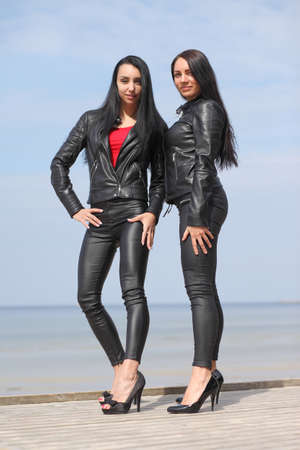 young slim sexy girl dressed in latex and leather