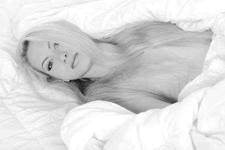 Portrait of gorgeous young girl in bed Stock Photo