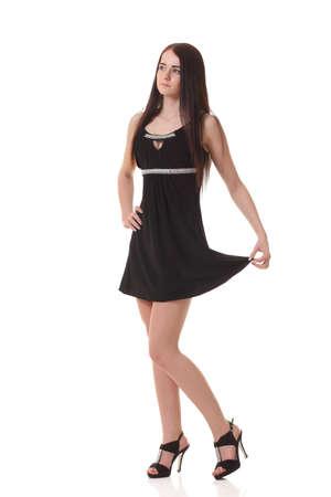 Jong meisje in zwart jurkje Stockfoto