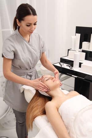 Cosmetic treatment at spa salon. Facial salon massage.