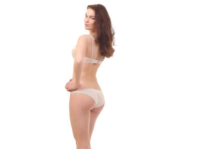 young woman with a slim figure in white lingerie Reklamní fotografie