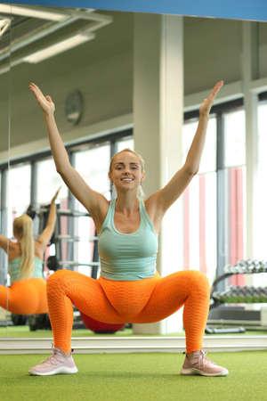 Pregnant young beauty woman doing prenatal yoga Reklamní fotografie